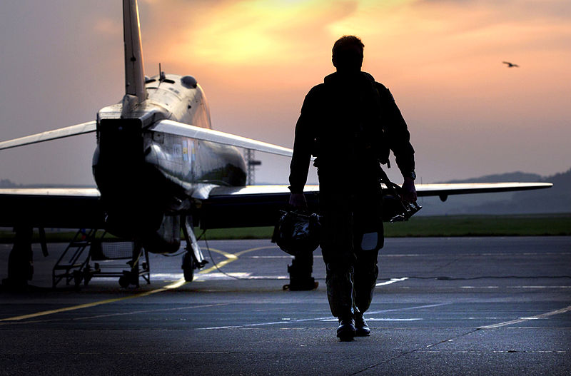 Pilot_Walking_Away_from_Hawk_Aircraft_in_Silhouette
